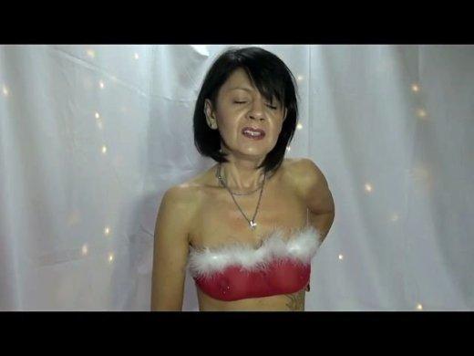 Weihnachtsfrau wixt den Weihnachtsmann